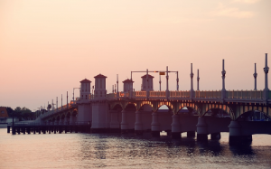 Image is of a bridge at dusk in St. Augustine.