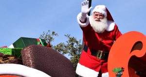 Image of Santa in a sleigh waving in the annual St. Augustine Christmas Parade
