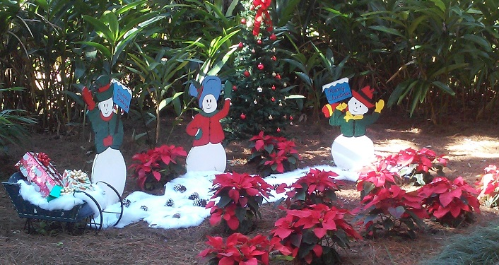 poinsettas and snowmen & women decorations at Holiday in the Gardens