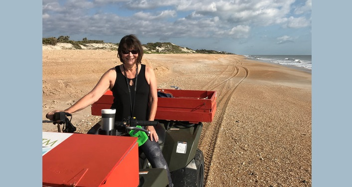 image of woman on the beach driving beach quad during Marine Turtle Patrol; included in New Volunteer Orientation at GTM
