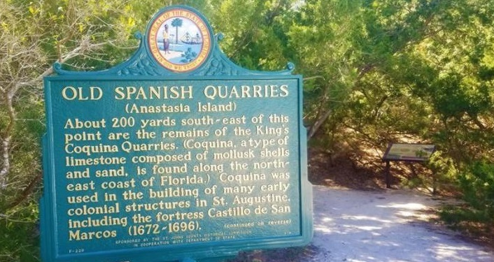 Historical marker sign with information about the Old Spanish Quarries at Anastasia State Park