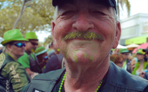 Image contains a man with a green beard.