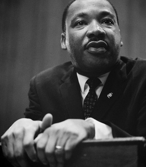 Image contains Dr. Martin Luther King Jr. at a podium.