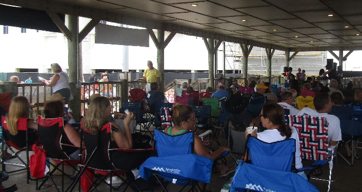 people sitting in chairs at pier park pavilion