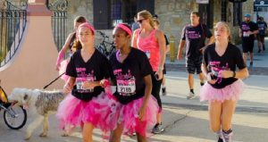 image of women dressed in black t-shirts and pink tu-tus for Pink Up The Pace