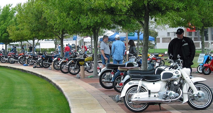 Classic motorcycles displayed around the lake at World Golf Village during Riding into History