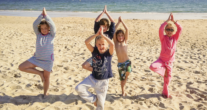 Have some fun at Kids Beach Yoga!