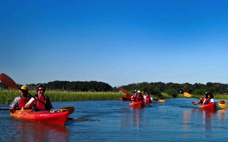 A kayak tour making its way through one of St. Augustine's canals.
