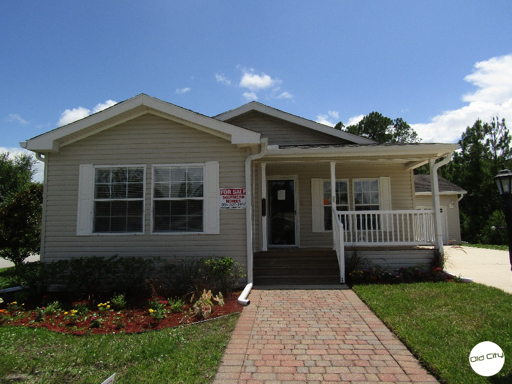 A House for sale in Coquina Crossing, a 55+ gated community.