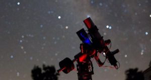 image of nighttime sky with telescope and stars used during Night Under the Stars