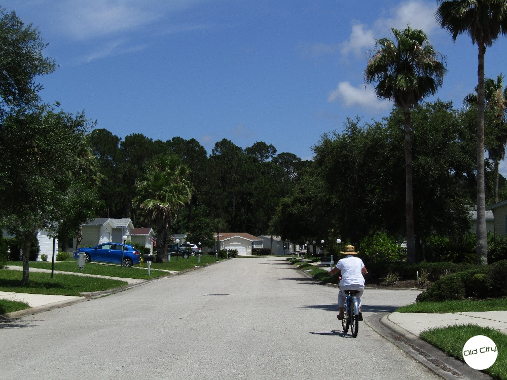 A Bicyclist riding through Coquina Crossing, a 55+ gated community