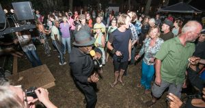 image of singer performing in the crowd of people dancing at St Benedict the Moor Blues Festival