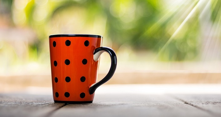 image of red, with black dots coffee cup used for Coffee with a Park Ranger