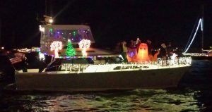 image of boat with Christmas decorations and lights participating in Holiday Regatta of Lights