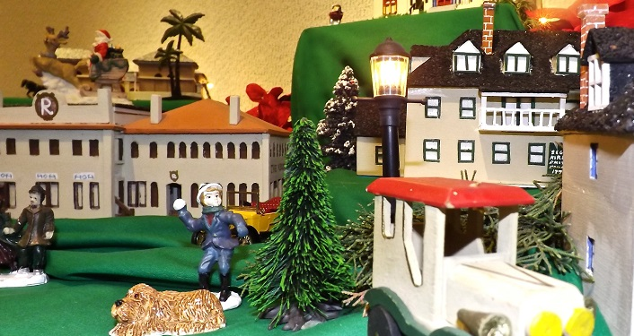 image of handmade miniature replicas of St. Augustine's historic buildings that are brought to life in Tiny Town: St. Augustine Miniature Holiday Village; building in historic district, tiny trees, people and cars