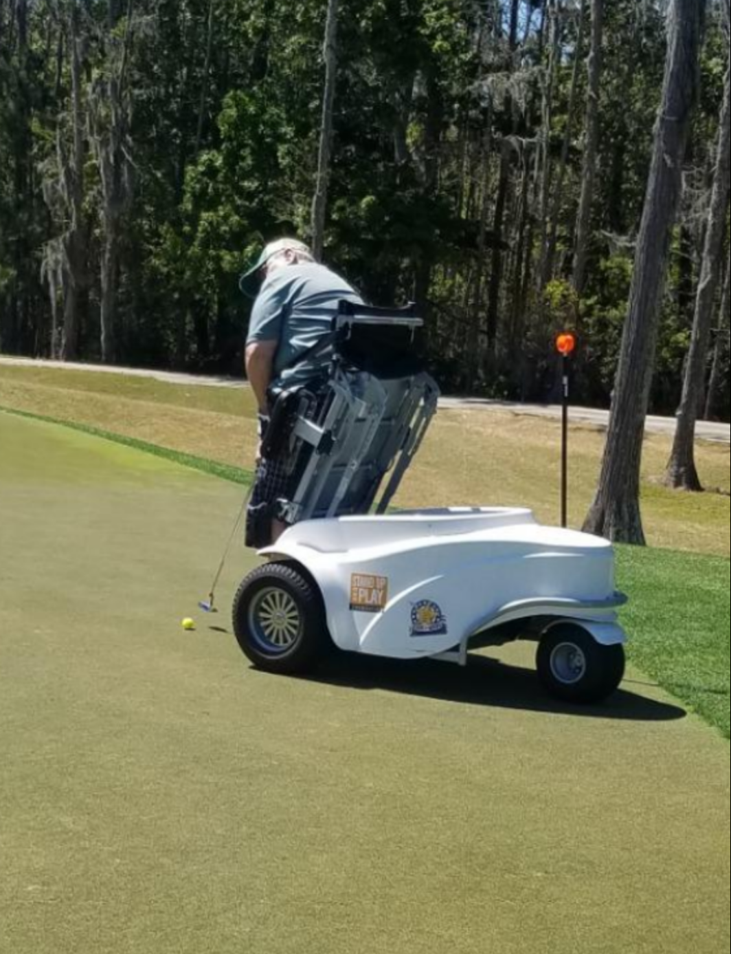 A man using a ParaGolfer to play golf.