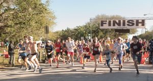 Image of runners, men & women - young & old, participating in Lightouse 5K