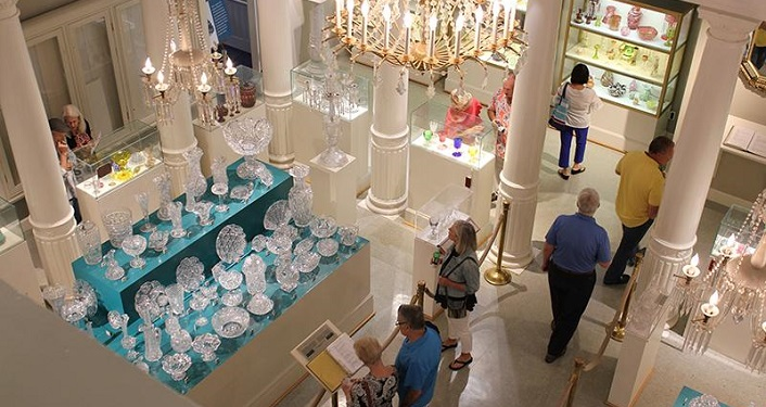 View from floor above of the Glass Gallery at Lightner Museum. Glass dishes, vases and more