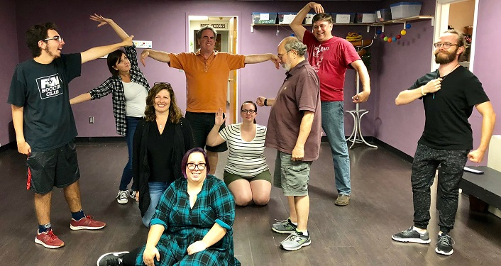 Men and women attending Improv basics class
