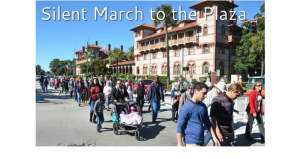 image of many people (young & old, men & women) in the Silent March to The Plaza celebrating Dr. Martin Luther King, Jr.
