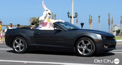 per dressed as Easter Bunny riding in convertible in the Easter Parade