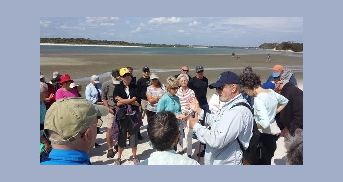 Several people at Matanzas Inlet listening to guide during a Matanzas Inlet Walk