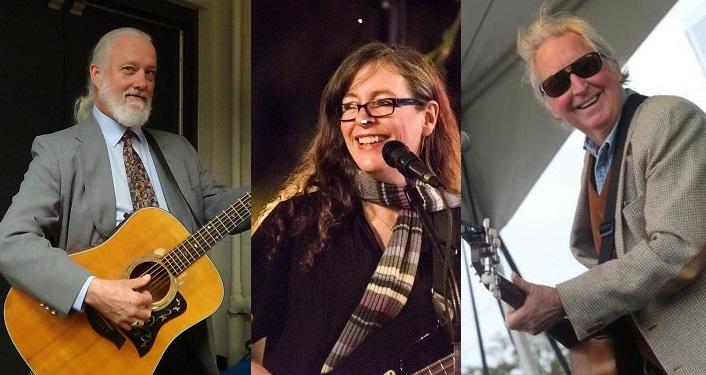 Image of 1 man playing guitar, woman playing guitar, and another man playing guitar.