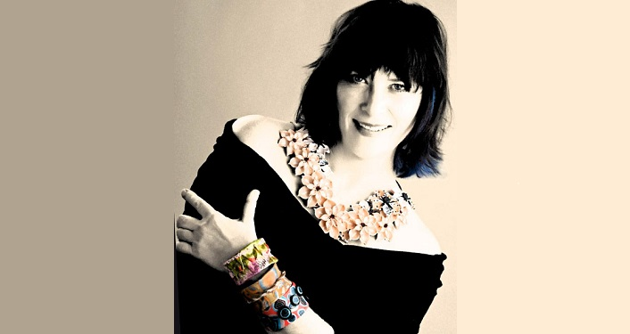 Image of Gloria Danvers wearing artistic jewelry that she made