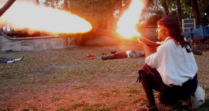 image of reenactor firing weapon during Drake's Raid & Encampment