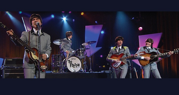 Image of The Fab Four on stage performing