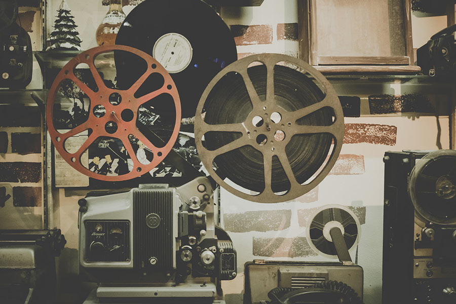 Two reels of film and film equipment.