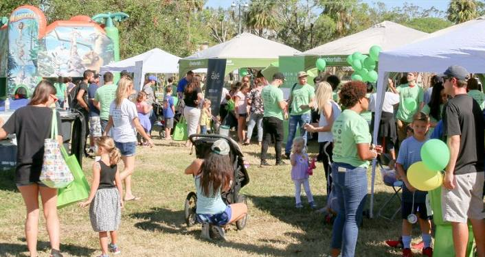 image of kids and parents by several booths outdoors at Ancient City Kids Day