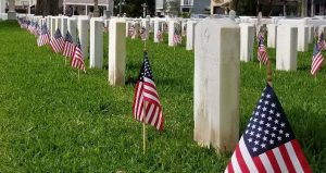 flags on graves for St. Augustine Memorial Day Observance