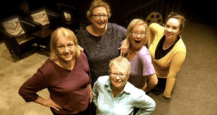 Image of 5 women looking up into the camera, standing with hands on hips, smiling for Mom*Prov - Improv Comedy Show