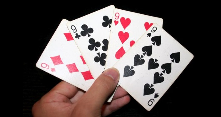 "image of hand holding all four ""9"" cards in their hand, Let's Play Cards!"
