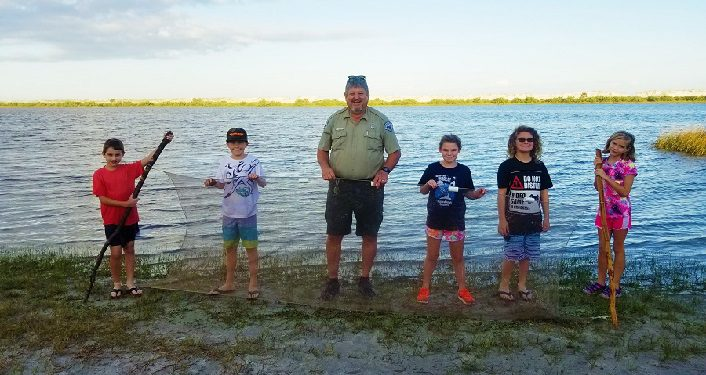 image of a couple of boys and girls standing with park ranger during Youth Fishing 101
