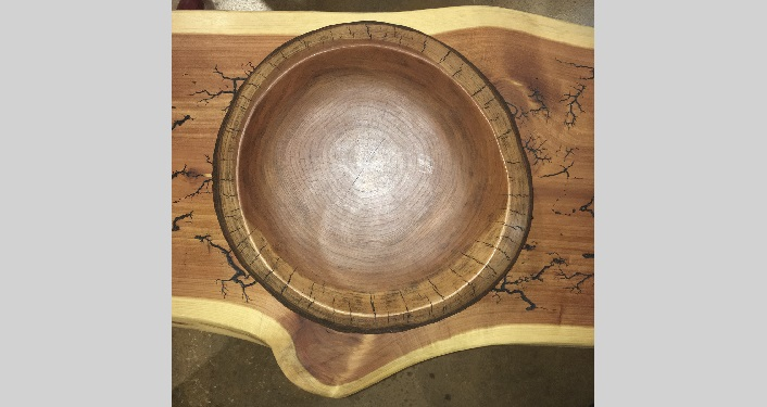 image of wooden bowl on wooden tabletop, carved by Jim Rivers