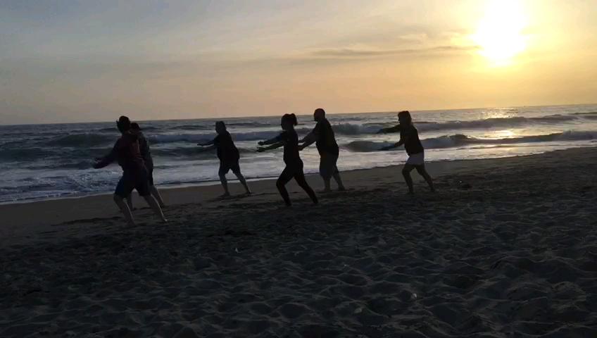 image of 5 people on the beach doing Sunrise Tai Chi