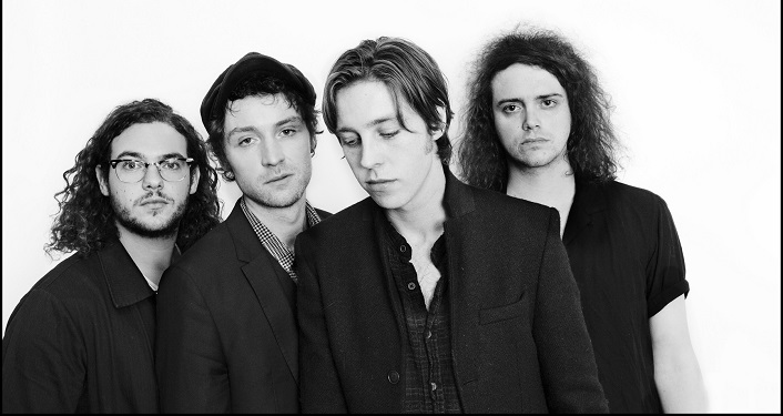press photo in black and white of Indie rock band Catfish and the Bottlemen, 4 young men dressed in black tops