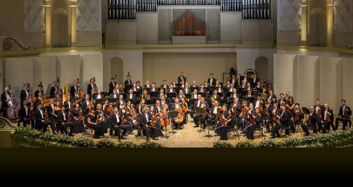 photo of the Russian State Symphony Orchestra onstage performing