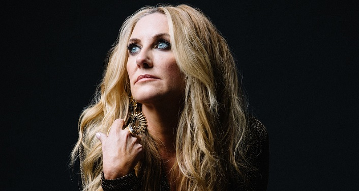 image of Grammy award-winning, singer/songwriter Lee Ann Womack; she has blue eyes, shoulder-length blonde hair. She's staring off to her right.