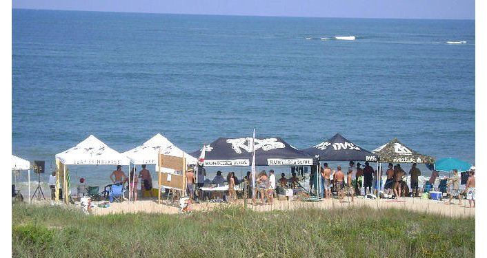 photo of tents set-up at Vilano Beach for vendors, contestants at Run Drop Slide FL Skimboarding Pro/Am