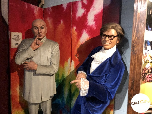 Image contains two life-size wax replicas of characters from the movie Austin Powers