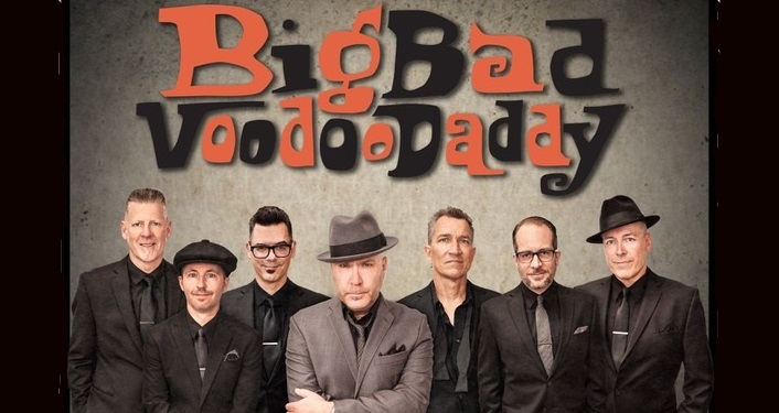 image of Big Bad Voodoo Daddy, 6 middle-aged men dressed in suits, 1 with cap, 2 with fedoras