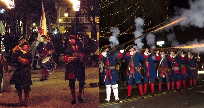 2 images of reenactors in period garb for Colonial Night Watch Parade; left side reenactors strolling down the street, one carrying American flag; image to right of soldiers firing the muskets for Volley of Joy