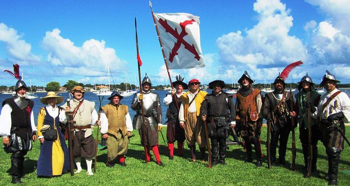 image with bayfront in background of men and women dressed in 1565 period garb for First Muster