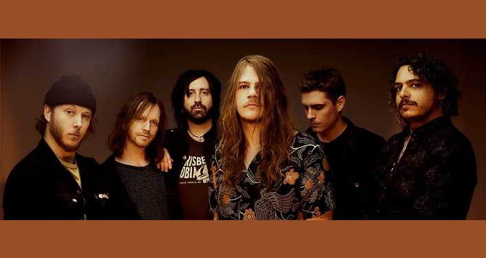 press photo of Canadian rockers, The Glorious Sons. 5 young men in mid to late 20's;one with long hair, 2 with short hair, 2 with shoulder-length hair