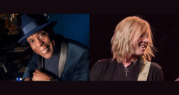 left side - image of Buddy Guy, black man wearing black shirt and hat; right side image of Kenny Wayne Shepherd white man wearing brown shirt, medium length blonde-ish hair