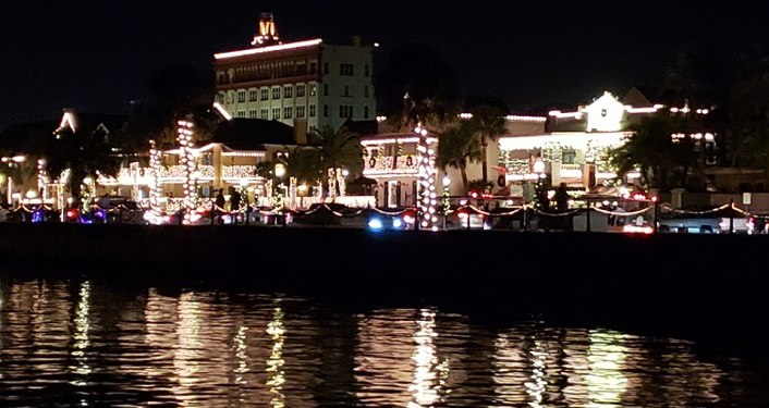 night time image of bayfront of St. Augustine seen from the water; building lit up with millions of tiny whtie lights for Nights of Lights