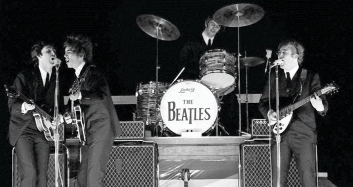 black & white image of The Beatles at Gator Bowl in 1964 during Hurricane Dora